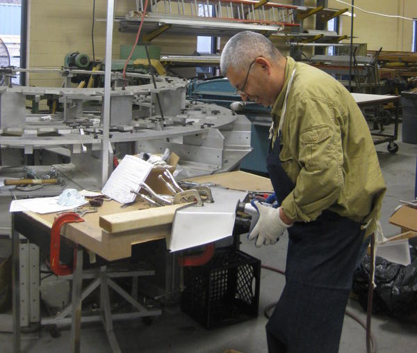 An employee at GSE Dynamics, a small manufacturing company that makes parts for the Navy and Air Force.