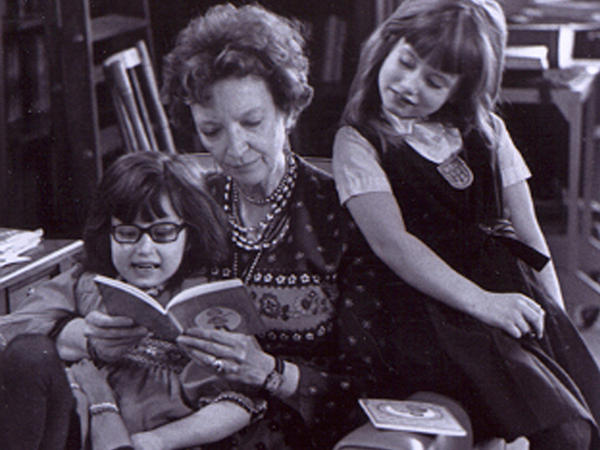 Madeleine L'Engle reads with her granddaughters, Charlotte and Lena, in 1976.