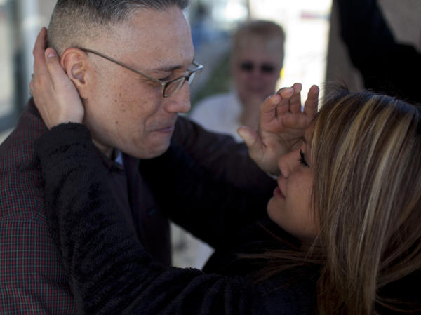 Ernie Lopez hugs his daughter, Nikki Lopez, for the first time since 2009. Ernie was released from prison on March 2 in Amarillo, Texas, after nine years, while he awaits a new trial.