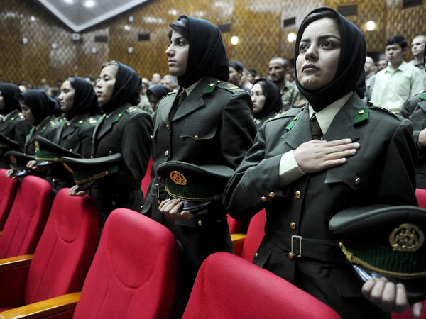 Afghan female cadets attend their graduation ceremony at the Military Training Center in Kabul, the Afghan capital, May 19. Some women say they joined the security forces in order to serve their country, but many say it's because the pay is better than working as a maid or teacher.
