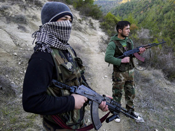 Members of the Free Syrian Army stand guard near the village of Ain al-Baida. The opposition says most of its weapons come from within Syria.