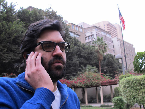 Sam LaHood of the International Republican Institute is one of 19 American democracy promoters who face charges of fomenting unrest in Egypt. Here, he is shown last month at the U.S. Embassy in Cairo.