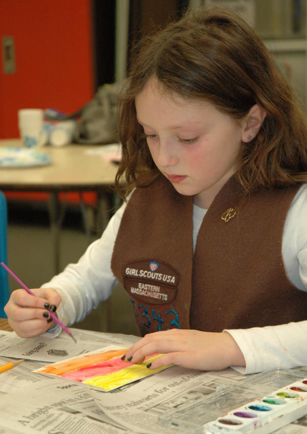 A member of Brownie Troop 65343 works on an art project at a troop meeting.