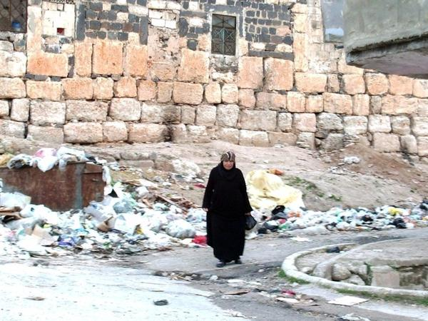 A Syrian woman walks along a street in the town of Rastan outside of Homs on March 11, 2012.