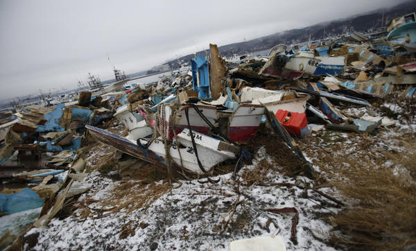 Demolished ships lie strewn about near the fishing port of Minamisanriku town, in Miyagi prefecture, northeastern Japan, Feb. 23, 2012. The local fisherman's union says last year's tsunami wiped out 90 percent of local fishing boats.