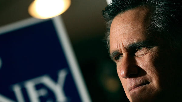 Mitt Romney waits to speak while being introduced Monday during a campaign stop in Mobile, Ala.