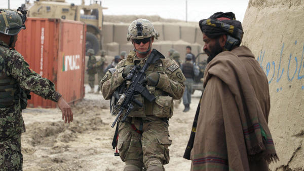 A U.S. soldier, part of the NATO-led International Security Assistance Force, stands outside a military base in Panjwai, Kandahar province, south of Kabul, on Sunday.