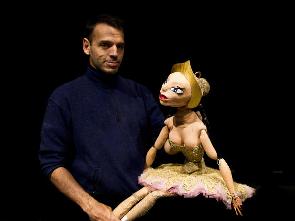 Puppeteer Basil Twist poses with Ballerina, the marionette at the center of a tragic love triangle in his adaptation of <em>Petrushka</em>.