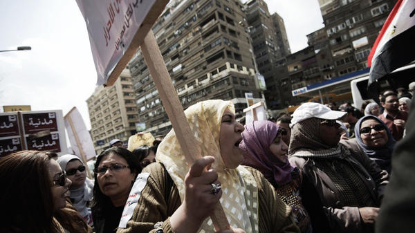Egyptians protest outside the administrative court in the capital, Cairo, on Tuesday. The protesters are calling for the panel drafting the constitution to be made up entirely of non-parliamentarians. Controversy swirls around the 100-member panel — handpicked by Islamist lawmakers — which includes only a handful of women and Christians.
