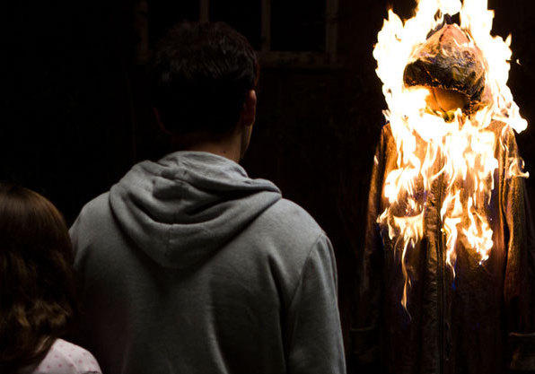 To show Mia her nightmares can't hurt her, John makes and burns an effigy of the bogeyman.