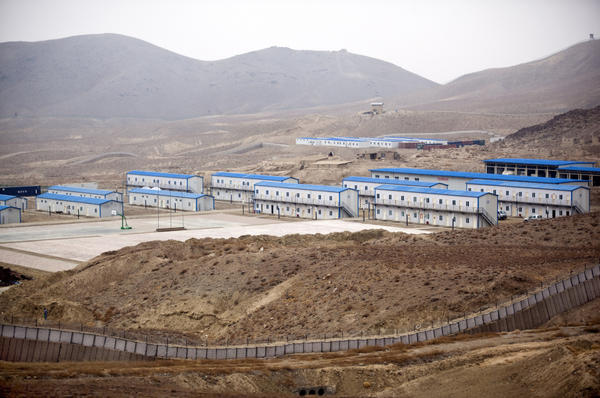 Hesco barriers and concertina wire surround the living quarters of the Chinese-owned Ainak copper mine in Logar, Afghanistan, in 2011.