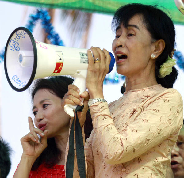 Myanmar opposition figure Aung San Suu Kyi speaks to  supporters on Saturday. Voting in parliamentary elections this Sunday is considered a test of the political reforms that Myanmar's rulers have introduced over the past year.