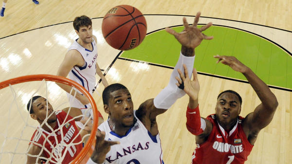 Kansas' Thomas Robinson (0) fights for a rebound with Ohio State's Deshaun Thomas (1) during the second half of an NCAA Final Four semifinal college basketball tournament game Saturday in New Orleans.