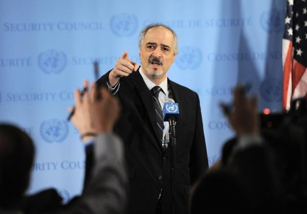 Bashar Ja'afari, Syria's Ambassador to the United Nations, points to reporters asking questions as he speaks to the media outside Security Council chambers on Monday.
