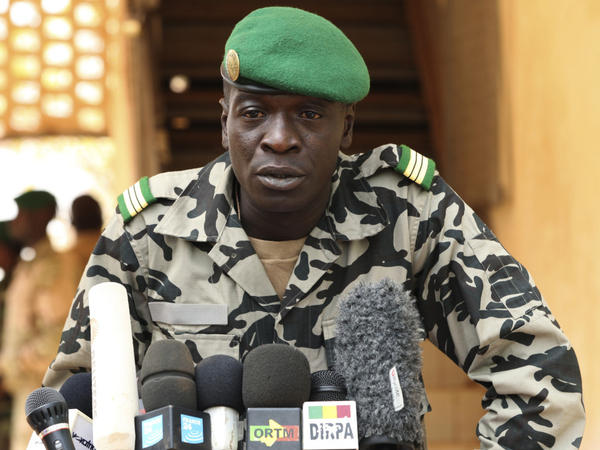 The leader of Mali's military junta, army Capt. Amadou Sanogo, speaks at a news conference outside the capital Bamako on Saturday. He says he wants to hold a consultative conference on Mali's future, but has not offered detailed plans.