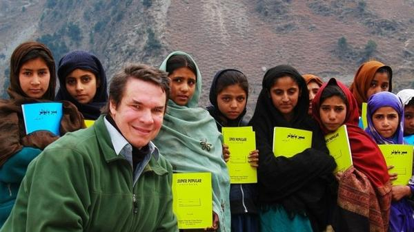 Greg Mortenson, author of <em>Three Cups of Tea </em>and <em>Stone Into Schools</em>, with schoolchildren in Azad Kashmir, Pakistan.