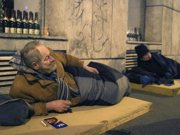Two homeless men lie on mattresses in central Budapest in 2010. Hundreds of people live on the streets in the Hungarian capital; many refuse to stay in night shelters for fear of having their goods stolen.