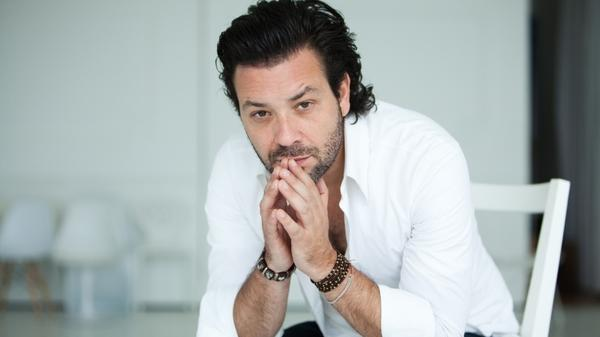 Adam Cohen says he's proud to be the son of singer Leonard Cohen.