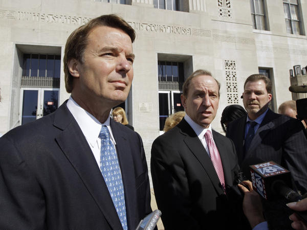 Former Democratic presidential candidate John Edwards (left) speaks to the media with attorney Abbe Lowell last October. His trial on alleged campaign finance violations is set to begin Thursday.