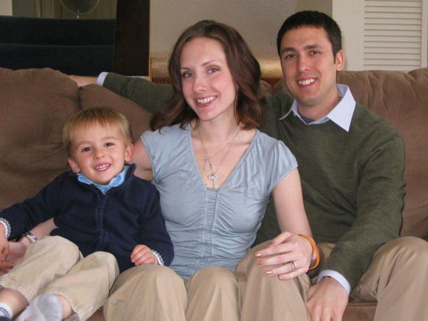 Surrogate Whitney Watts with her son, J.P., and husband, Ray. She says she was motivated to help others have a family because her own parents had infertility problems.