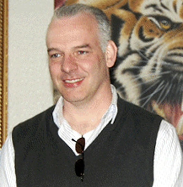 British businessman Neil Heywood, seen in April 2011, was found dead in a hotel room in the Chinese city of Chongqing in November. An official announcement last week said Gu Kailai, the wife of Bo Xilai, is suspected of murder.