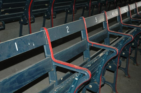"""Fenways boasts """"the oldest seats in baseball."""" Owners purposely decided not to sandblast the layers of paint, but rather to let these right field grandstand seats show their history and their age."""
