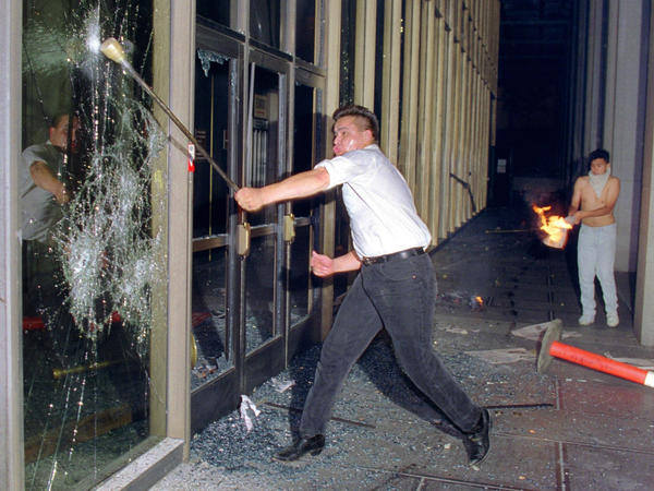 A rioter breaks glass at the Criminal Courts building in Los Angeles on April 29, 1992, after a jury acquitted four police officers accused of beating Rodney King.
