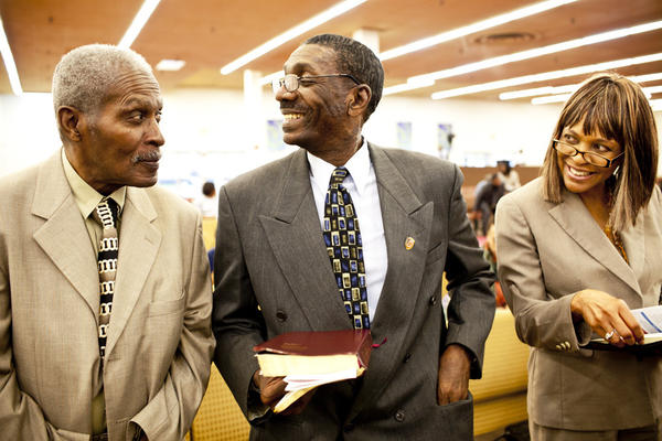 Natasha Shamone-Gilmore (right) at church with her husband, Curtis Gilmore (center), and her father, Franklin Brunson, 81. Shamone-Gilmore moved her father into her Capitol Heights, Md., home after he developed dementia.