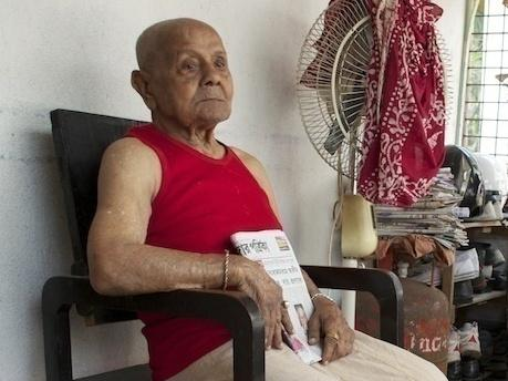 "Centenarian Manohar Aich sits at his home in Kolkata, India. Aich stood 4 feet 11 inches at his tallest, earning him the nickname ""Pocket Hercules."""