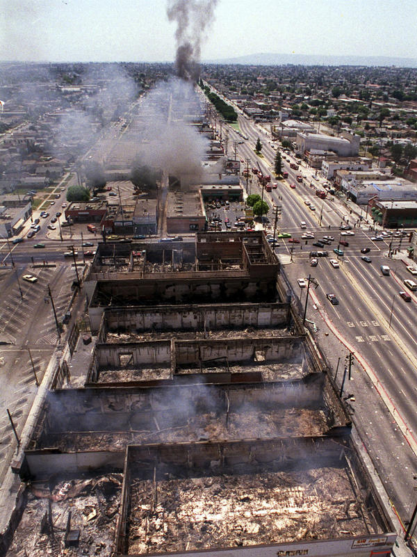Smoke rises as fires burn out of control near Vermont Street in Los Angeles on April 30, 1992. Riots erupted after L.A. police officers were acquitted in the beating of black motorist Rodney King.