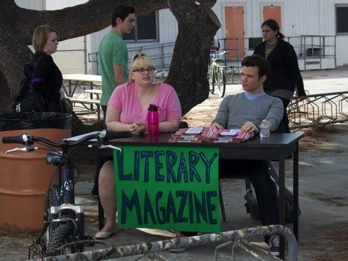 Carson Phillips (Chris Colfer) and Malerie Baggs (Rebel Wilson) try to drum up support for their school's literary magazine in the dark comedy <em>Struck By Lightning</em>, for which Colfer wrote the screenplay.