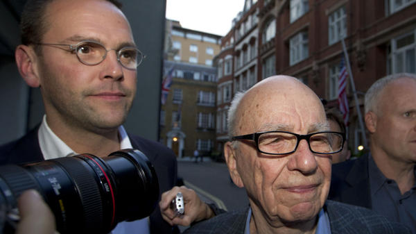 An influential group of British lawmakers says Rupert Murdoch, shown above with his son James (left) last July, is unfit to lead his global media empire. The scathing report also says his company misled Parliament about the scale of phone hacking at one of its tabloids.
