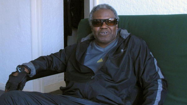 Veteran James Brown relaxes in his apartment, which he recently moved into after spending decades on the streets.