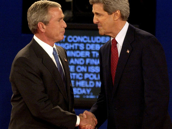 President Bush and then-Democratic presidential nominee John Kerry shake hands at the end of a presidential debate in 2004 in St. Louis. Researchers want to better understand why partisans' views of the facts change in light of their political loyalties.