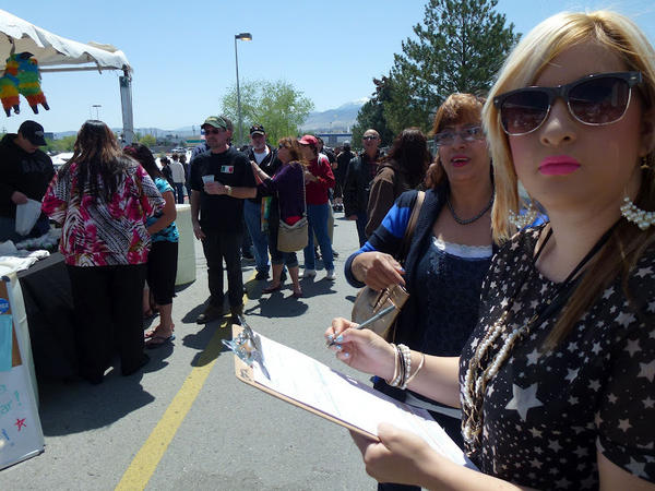 Caroline Maya, a 21-year-old college student, registers to vote for the first time at the Latinos for Obama booth outside the Grand Sierra Casino in Reno, Nev., Saturday.