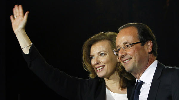 French President-elect Francois Hollande waves to supporters with his companion, Valerie Trierweiler, as he celebrates his election victory in Bastille Square in Paris, May 6. Hollande and Trierweiler will be the first unmarried couple to move into the French presidential palace.