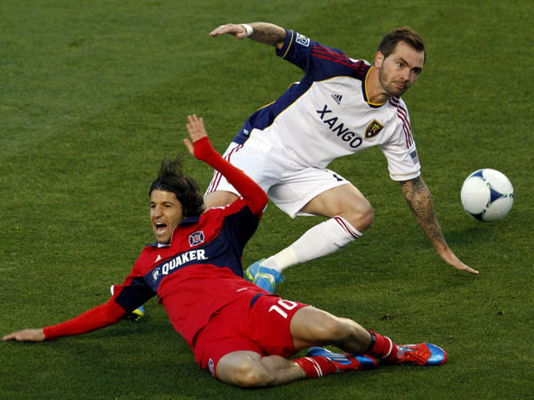Real Salt Lake's Jonny Steele (right) trips Chicago Fire's Sebastian Grazzini during a Major League Soccer matchup. The game ended without a score — one of 11 ties each MLS team is likely to record this season.