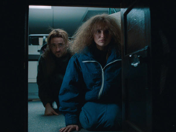 John Cusack and Cameron Diaz in <em>Being John Malkovich</em>.
