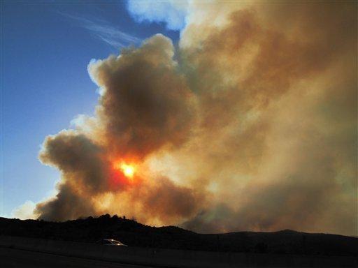 A fire blazes in Arizona's Tonto National Forest, near Payson, Ariz., on May 12, 2012.