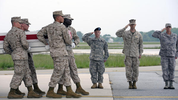 A Marine Corps team carries the remains of Marine Sgt. J.P. Huling, 25, of West Chester, Ohio, at Dover Air Force Base, Del., on May 9. Huling was killed three days earlier by an Afghan soldier in southern Afghanistan, one of a growing number of such shootings.