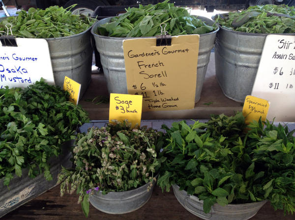 Assorted herbs and greens from Gardeners Gourmet of Westminster, Md., at the Eastern Market in Washington, D.C.