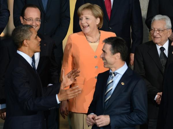 President Obama talks to German Chancellor Angela Merkel, French President Francois Hollande (upper left), NATO Secretary-General Anders Fogh Rasmussen (center) and other leaders during the official photo at Soldier Field in Chicago during the NATO summit Sunday.