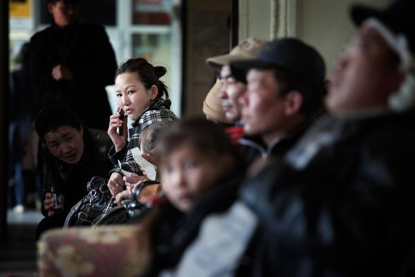 Passengers wait for trains at Ulan Bator's central station. Mongolians are flocking to the mines in search of better-paying jobs.