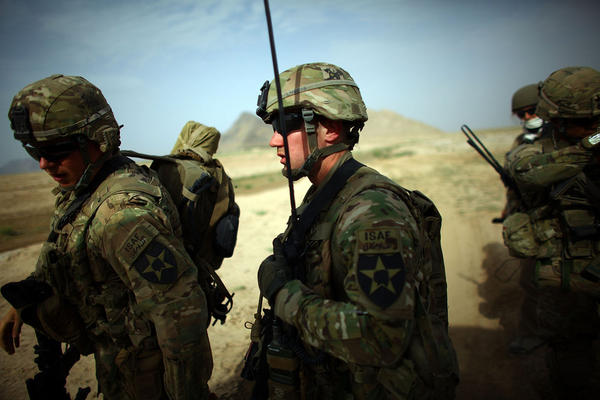 Capt. Chris Longto, of Joint Base Lewis-McChord Stryker brigade, heads out on patrol with Afghan soldiers in a rural area of Kandahar province, where the Taliban is still a threat.