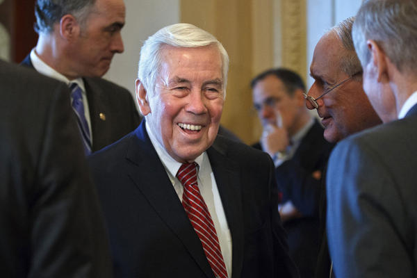 Sen. Richard Lugar, R-Ind., 80, faces a GOP primary battle Tuesday that could end his political career. Here, Lugar talks with Capitol Hill colleagues on March 6.