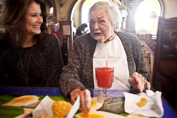AnnaBelle Bowers, 87, has lunch with granddaughter Kelley Hawkins in Harrisburg, Pa. Kelley and her sister-in-law, LaDonna Martin, jointly care for AnnaBelle.