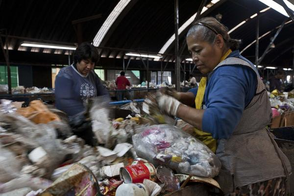 Sorters look for recyclables at the Bordo Poniente landfill on the outskirts of Mexico City, Mexico. The landfill has since been closed.