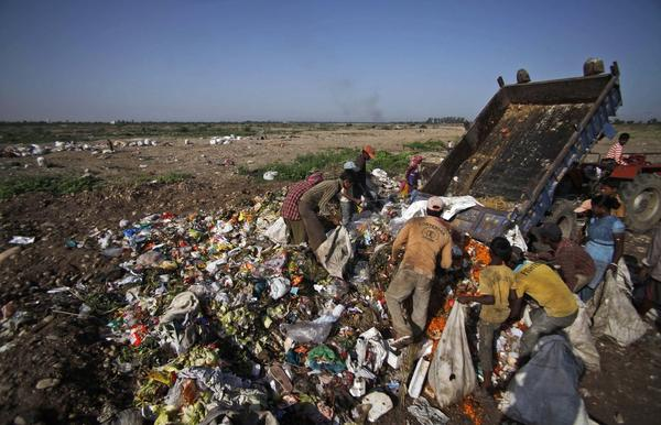 Ragpickers comb a garbage dump on the outskirts of Jammu, India.