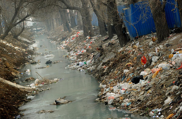 Trash clogs a canal on the edge of Beijing, China.