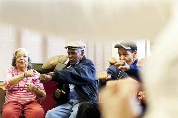 Franklin (center) makes a punching movement in a self-defense exercise during his tai chi class.